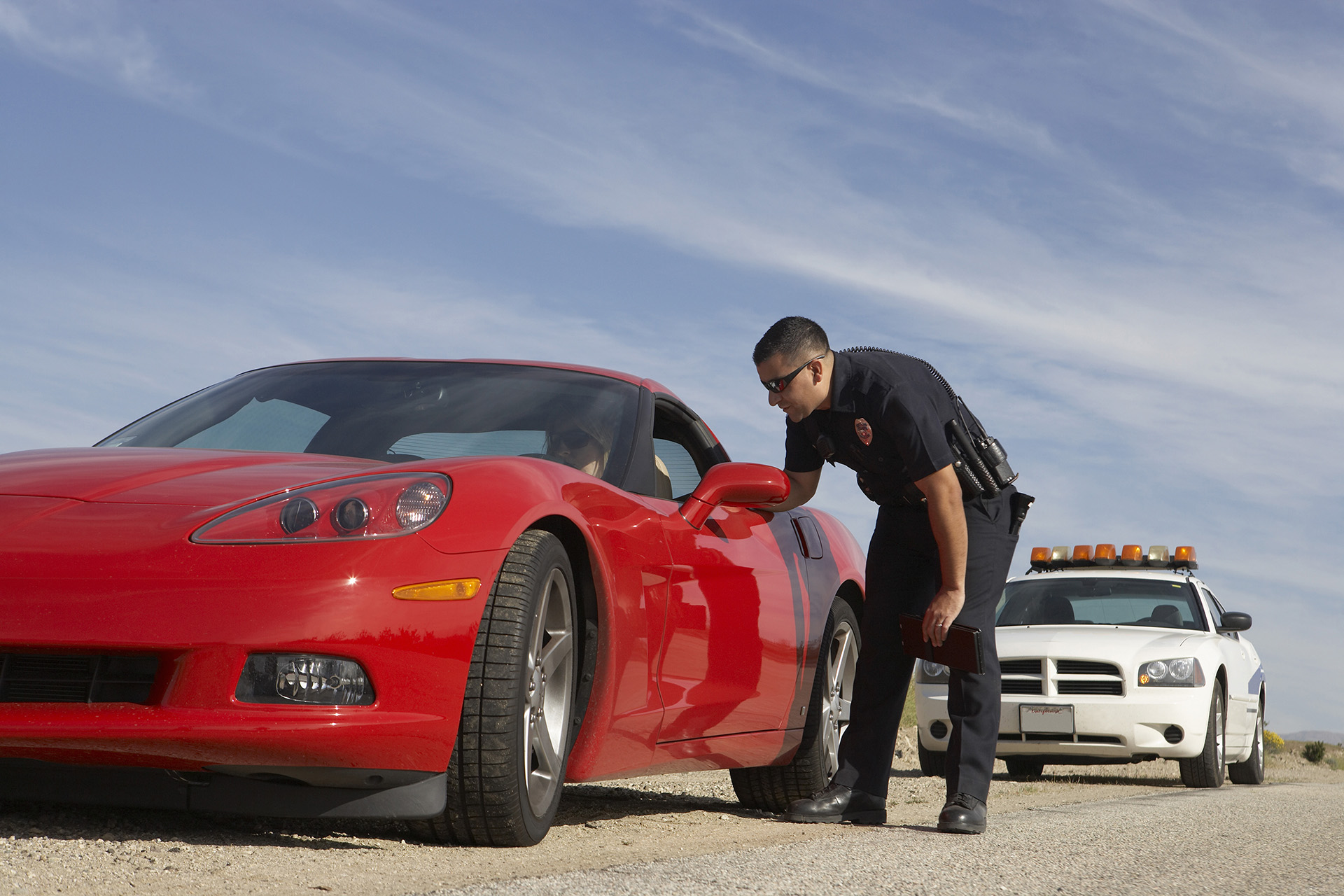 Police Officer Pulled Over a Red Sports Car for a Highway Traffic Act Violation